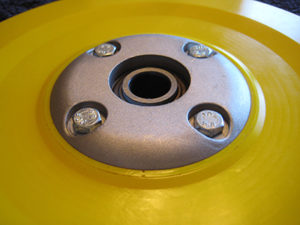Duralok seed lock wheel with replaceable bearing for no till drills